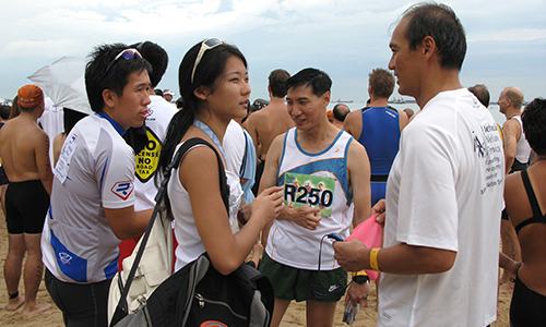 Three pastors take part in Osim Singapore International Triathlon to raise funds