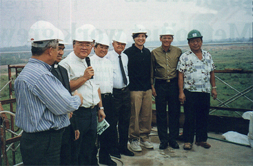 Up on the roof: CAC pastors, lay leaders, site architect and contractors at the topping-up ceremony, which marks another milestone for Sengkang Methodist Church. -- CAC picture by the REV LEK YONG TECK.